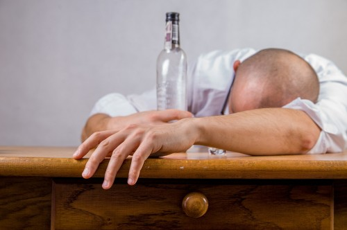 alcohol-428392_1280 Three lies: Photo of man with bottle passed out on desk.