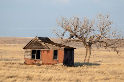 Fear of not enough: photo of old empty shack.