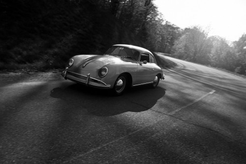 classic-691043_1280 Drive safe: 4 ways to keep your car distraction free. B&W photo of old sports car on the highway
