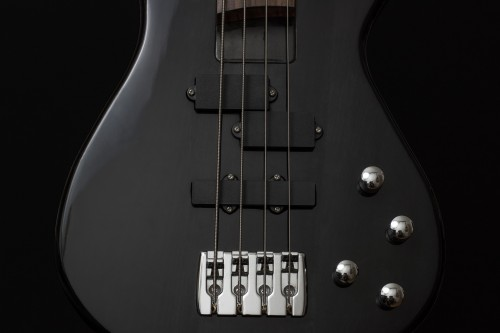 guitar-811343_1920 5 Ways Music Can Keep You Healthy: Photo of a black bass guitar
