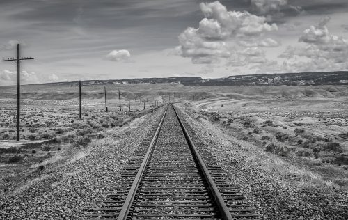 black-and-white-1283768_1920: B&W photo of train track in the desert.
