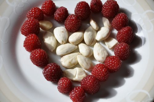 heart-194542_1920 The Minimalist Vegan: Photo of heart-shaped strawberry and almonds.
