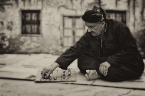 man-798989_1920 From Games To Bookstores: Photo of an old man playing a board game.