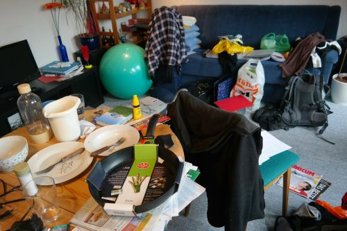 Analyzing the mindset of clutter: Photo of cluttered room.