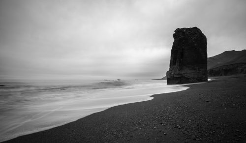 Keep calm and practice relaxation: B&W photo of seaside scene.
