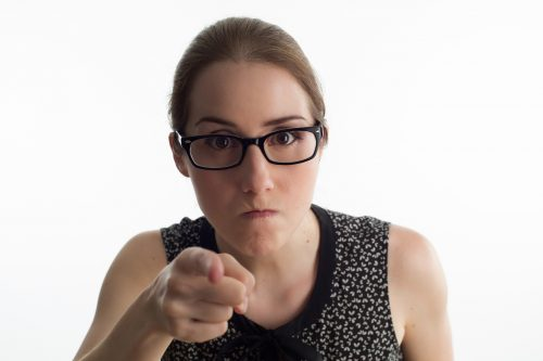 4 types of toxic people to avoid: Photo of angry woman pointing at you.