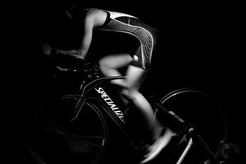 Creative exercise: B&W photo of someone using a bike trainer.
