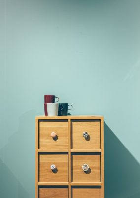 The disciplined art of less: Photo of simple drawers with cups on top.