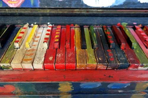 5 reasons to play a musical instrument: Photo of brightly painted piano keys.