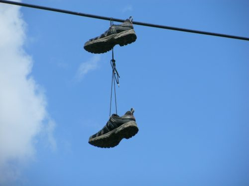 Slacked? 3 things you can do to get back on the track: Photo of running shoes hanging from power wires.