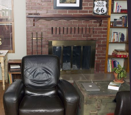 Photo tour: Chair in front of fireplace.