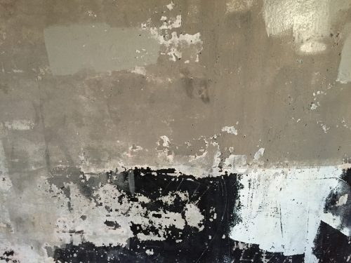 Taking minimalist photos: Abstract of concrete wall close up.