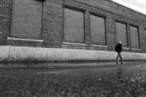 The most minimalist outdoor exercise: Photo of man walking in the city.