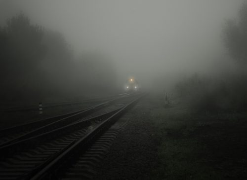 Ghosts: photo of a train at night in the fog.