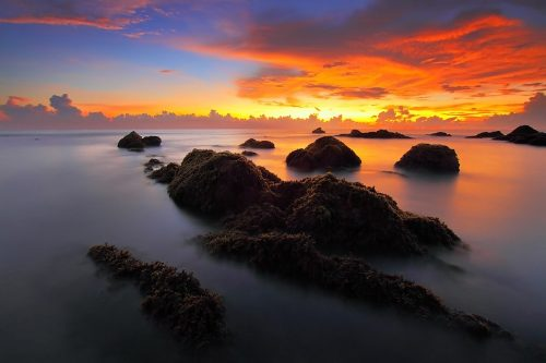 Morning routines: Photo of sunrise on the sea.