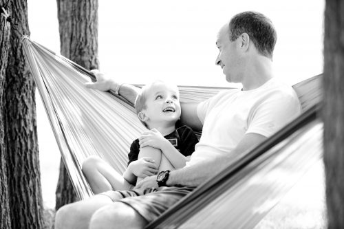 One big payoff for practicing minimalism: Photo of dad spending time with toddler son.