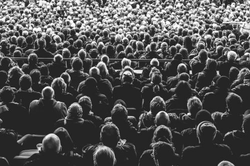 How joining the crowd will actually hold you back: Photo of a crowd.