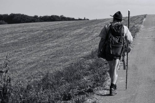 3 ways the walking life could save your life: Photo of man walking on side of road.