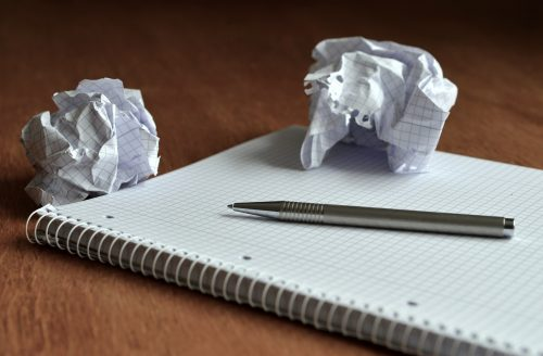 The perfect plan for self-improvement is simple: Photo of blank note pad and crumpled paper.