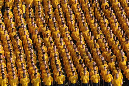 Break free from the tribe: Photo of a large group all dressed the same.