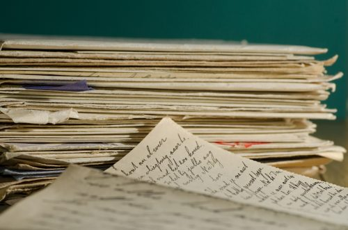 Paperwork: photo of stacks of letters and papers.