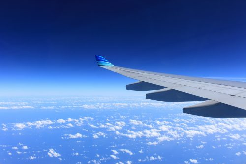 25 reasons to stop fearing change: Photo of airplane wing and blue sky.