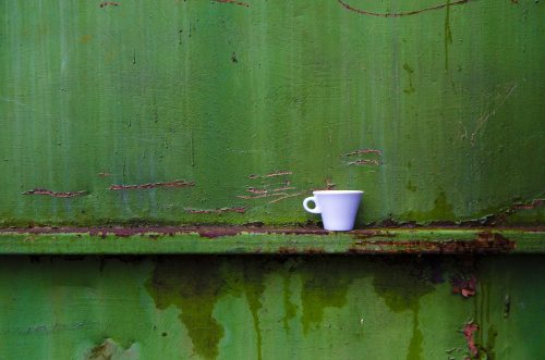 How to downsize for life: Photo of coffee cup in a steel container.